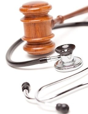 A Gavel and Stethoscope on a white background