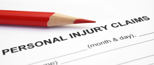 Paperwork for a personal injury claim waits to be filled out