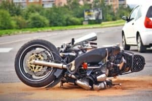 A motorcycle lies on the street after an accident