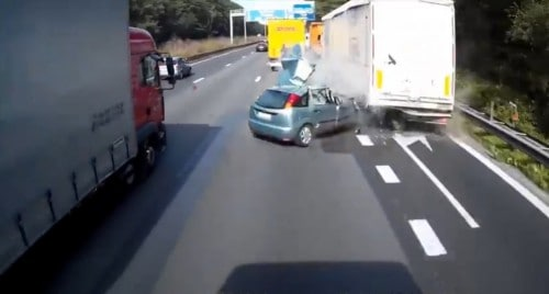 A compact car is crushed by a truck