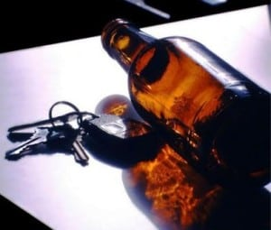 An empty beer bottle lies next to car keys