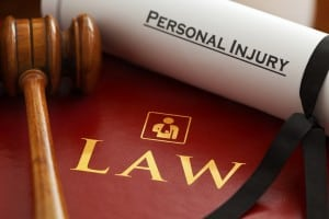 Personal Injury certificate, a gavel and a law book