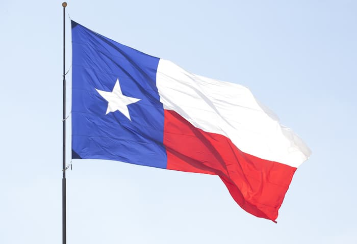 Texas flag flying in sky