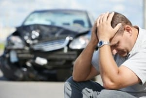 wreck car and distraught man