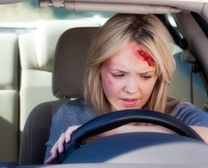 A woman is dazed after hitting her head on the steering wheel after an accident
