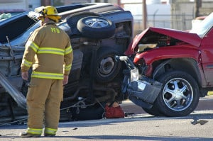 A first responder takes in the scene of an accident caused by distracted driving.