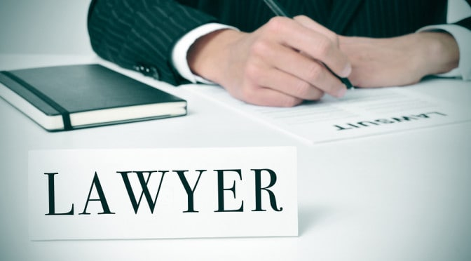 A personal injury lawyer begins paperwork on a new lawsuit