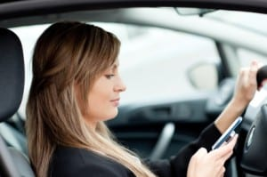 A Driver is distracted by her cell phone