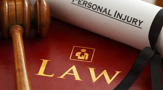 A law book, a Gavel and a Personal Injury Certification