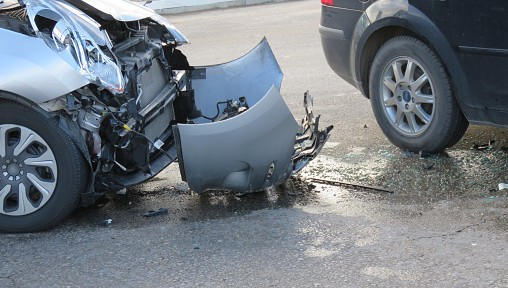 The severely damaged front end of a car resulting from an accident