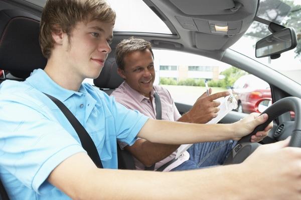 teen boy driving car