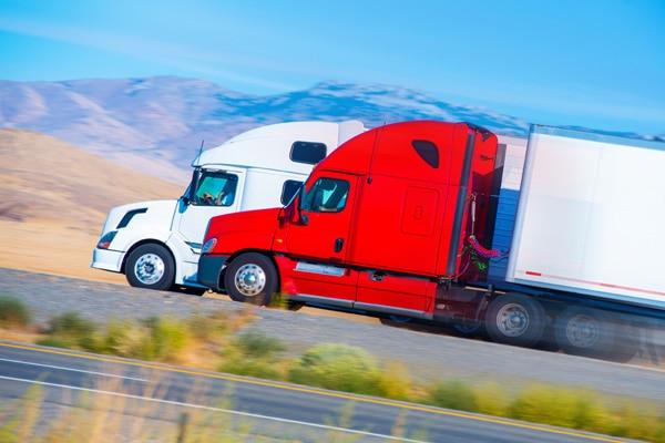 two semi trucks on highway