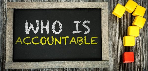 Who Is Accountable? written on chalkboard