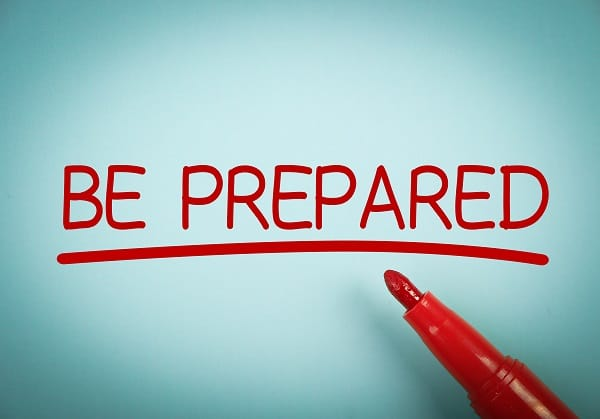 Be Prepared text with red underline is written on blue paper.