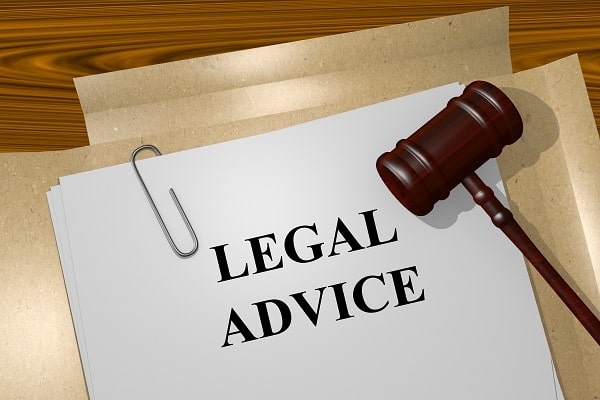 A gavel on a report labeled Legal Advice