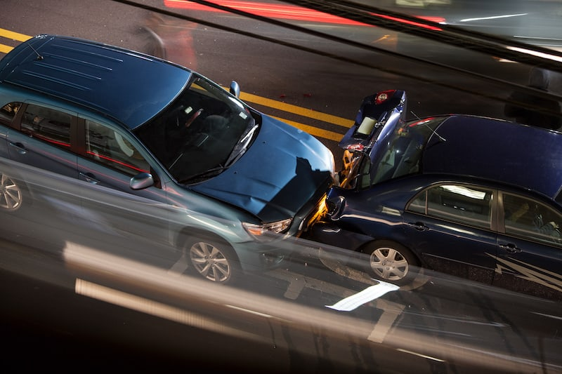 Overhead view of a car accident on a busy street