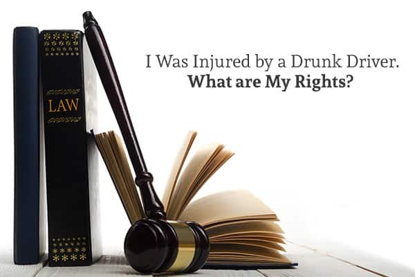 "Two law books stand beside another one that is lying down, open. A gavel leans against them and there are the words ""I Was Injured by a Drunk Driver. What are My Rights?"""