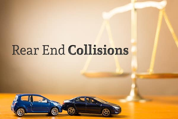 "Two cars have collided with a scale in the background and the words ""Rear End Collisions"""